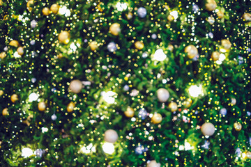 Abstract blurred background of christmas tree with bokeh light