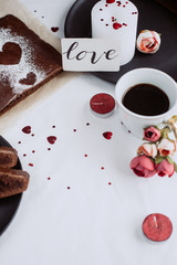 A cup of coffee and baked homemade pie, with heart  with candle on on white background. Healthy homemade whole grain pie. Valentines day   or mother's day