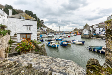 View between cottages, at the historic fishing harbour of Polperro, Cornwall. Wall mural