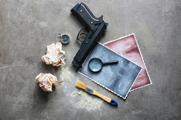 Composition with different items for detective on grey background