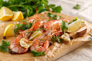Grilled shrimps with spice, garlic and lemon. Grilled seafood.