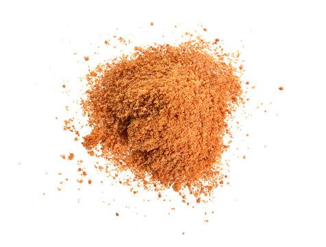 Coconut sugar, also known as coco sugar, coconut palm sugar, coco sap sugar or coconut blossom. Isolated on white background