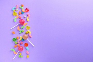Tasty sweets on color background