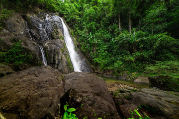 Waterfalls in the rainforest photographed in Khao Yai National Park, Thailand.