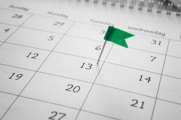 Calendar with pinned date, closeup
