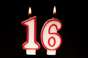 16 birthday candle on black background