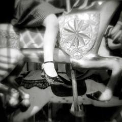 Girl sitting on carousel