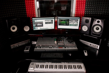 DJ Studio equipment. Mixing console on the table. Empty recording Studio room