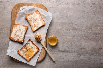 Composition with tasty toasts and honey on table