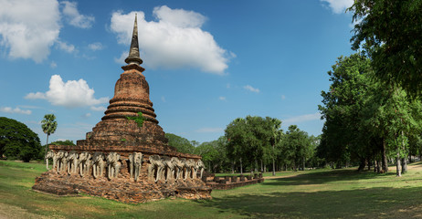 Ancient stupa with sculpted images of elephants. Thailand