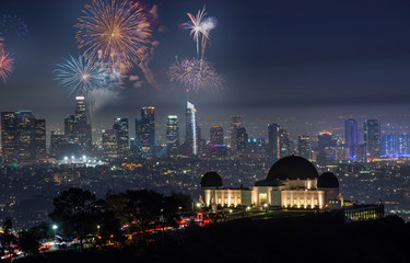 Downtown Los angeles cityscape with fireworks celebrating New Year's Eve.