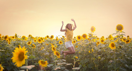 Beautiful woman in a field of sunflowers