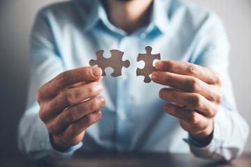Businessman holding puzzle