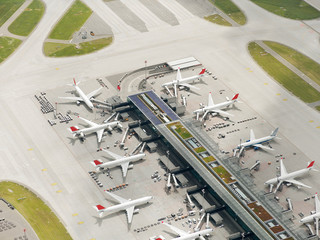 Aerial view of airplanes at airport terminals