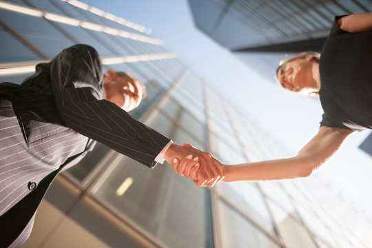 Low angle view of businesspeople shaking hands