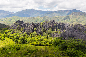 Sharp needles of black volcanic peaks. Mountains near Mont Aoupinie and Poya river, aerial view. North Province, New Caledonia, Micronesia, overseas territory of France, Oceania, South Pacific Ocean.