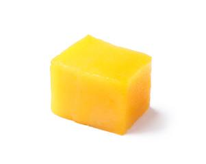 Fresh juicy mango cube isolated on white