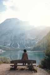 Girl sitting on Bench by Beautiful Lake