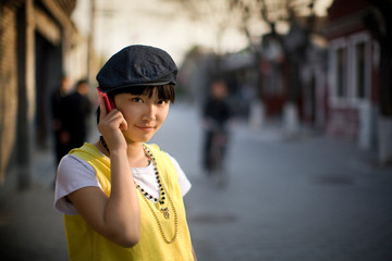 Portrait of a young adult woman talking on a cellphone.