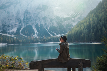 Girl sitting on Bench by Beautiful Lake