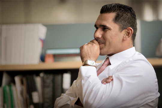 Mid-adult businessman sitting in an office.