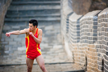 Chinese Olympian at the Great Wall of China.