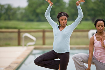 Portrait of two young woman doing yoga.