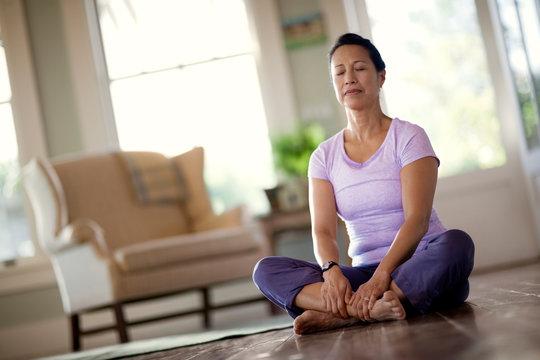 Woman meditating after finishing yoga.