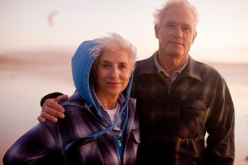 Senior couple standing on beach together