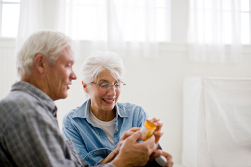 Senior couple looking at a medicine bottle.