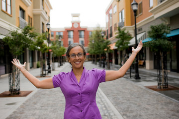 Woman gesturing on shopping street