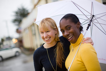 Couple outside with umbrella