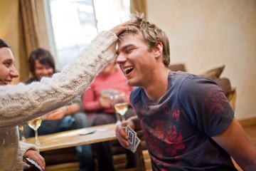 Woman ruffling her boyfriend's hair