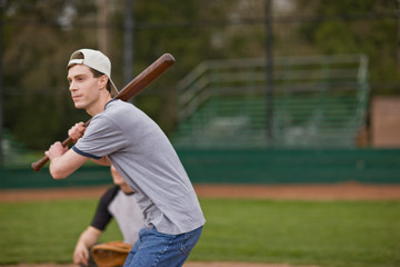Man preparing to bat while playing baseball