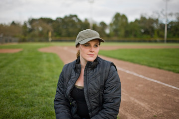 Woman sitting on sport field