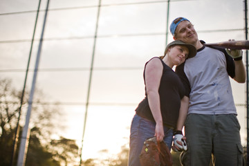 Couple standing on sport field holding hands