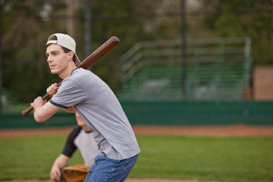 Man preparing to bat while playing baseball