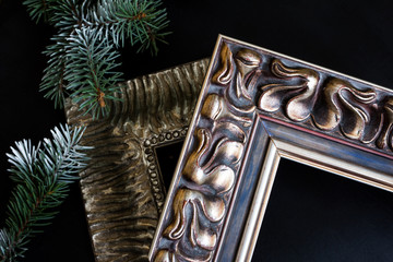 Vintage picture frames with pine branch. Framing workshop concept.