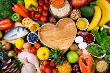 Background healthy food for heart. Fresh fruits, vegetables, fish, meat, berries and cereals. Healthy food, diet and healthy life concept. Top view, copy space