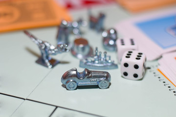 Game monopoly close up. Game chips, game cubes