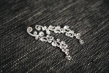 Women's wedding jewelry (earrings) on a dark background, selective focus