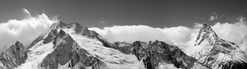 Fototapete - Panorama of snowy covered mountain peaks