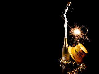 Happy new year, Champagne pops with sparkles