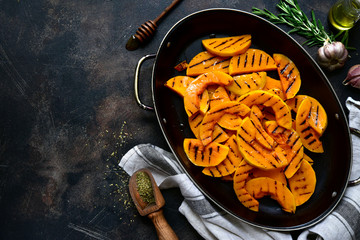 Grilled pumpkin slices.Top view with copy space.
