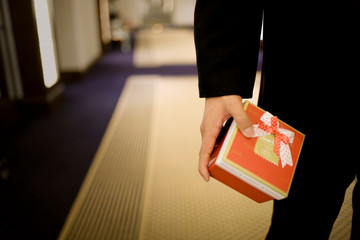 Gift being held by a businessman.