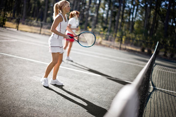 Women playing tennis