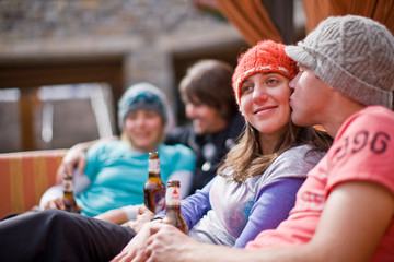 Friends relaxing at a ski lodge