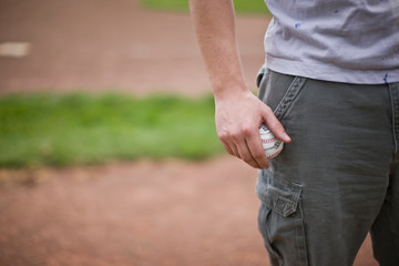 Man holding baseball on sport field
