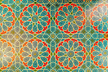 Colorful geometric pattern of Islamic mosaic decorated walls in Morocco