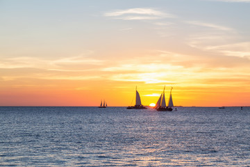 Beautiful golden sunset viewed from Mallory Square in Key West, Florida Keys, United States.